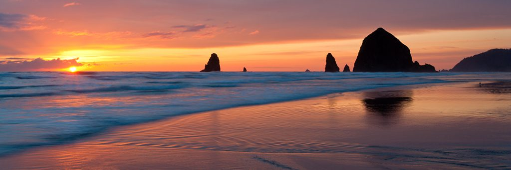 Panoramic photo of Haystack Rock, Cannon Beach, Oregon.