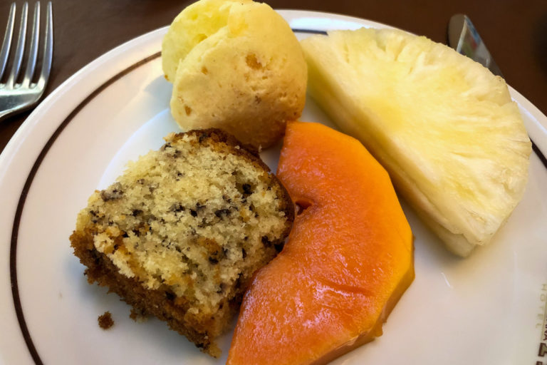 Coconut-chocolate-chip cake, papaya, pineapple, and cheese bread