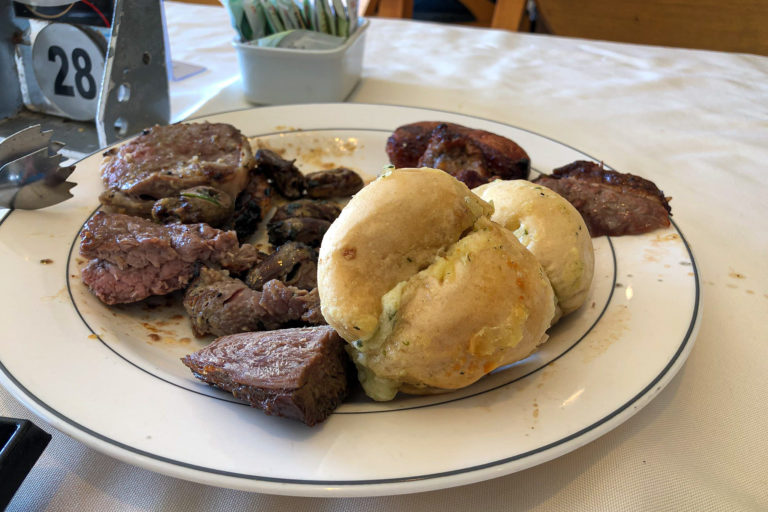 Beef, chicken hearts, and pão de alho (garlic rolls)